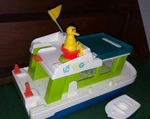 1970's Fisher Price Little People, Happy Houseboat #985. Includes Little Tug Boat and Big Bird.