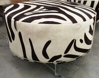 B & S Furniture's Hair on Hide Ottoman with Lucite Legs