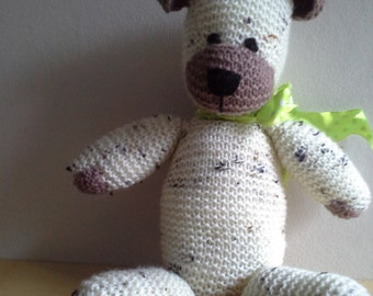 Cream and brown teddy with ribbon.