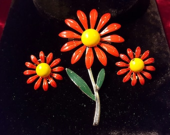 Beautiful, 60's, metal, flower, brooch and clip earring set with bright orange and yellow enamel!