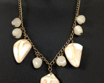 Fossil and pebble necklace