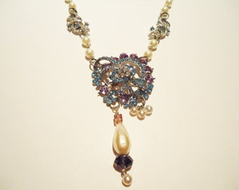 Vintage blue and purple rhinestone, pearl and glass assemblage necklace. 25 inch length