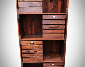 Industrial style bookcase with four storage crate.