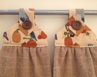 Kitchen towels set of 2. tan  towels with fall fabric top,brown button over  velcro closure