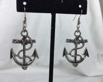 Large metal anchor dangles