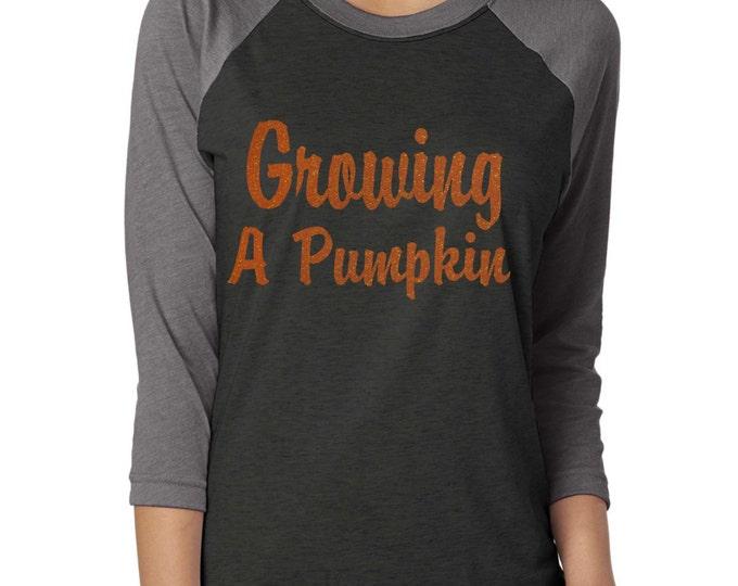 Growing A Pumpkin 3/4 sleeve Shirt. Halloween Maternity Shirt. Funny Mom To Be ladies adultT-shirts. Maternity halloween raglan t-shirt.