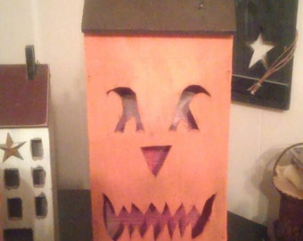 "Handmade wooden primitive Jack o lantern saltbox houses stand approximately 18"" x8"" hole for clip light in back"
