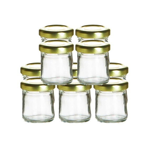 Display candy, crackers, cookies, colorful soaps, and more in these clear glass storage jars with twist-on metal lids. Their attractive ribbed designed looks great in home or office, but are also ideal for organizing nuts and bolts, pet treats, craft supplies, small toys, and more.