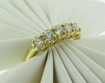 14 K Gold and Cubic Zirconia Wedding Band