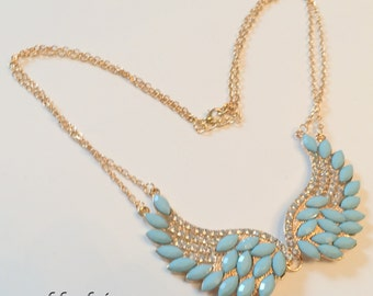 Angel wings in turquoise
