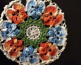 Crocheted doily, plate cover with pansies in tangerine and blue