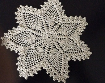 Elegant vintage ecru crocheted doily in star design