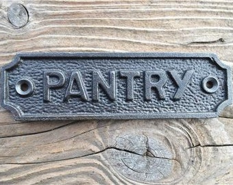 A lovely vintage style cast iron pantry door sign