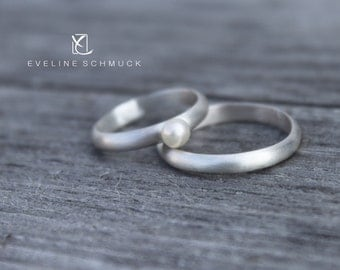Sterling silver set of his and hers wedding bands in textured Weding rings