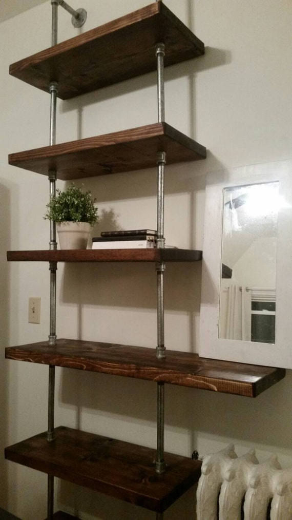 rustic industrial pipe and wood shelving unit floor to ceiling. Black Bedroom Furniture Sets. Home Design Ideas