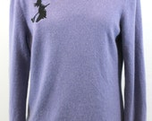 Lavender cashmere sweater w/ witch on broom design