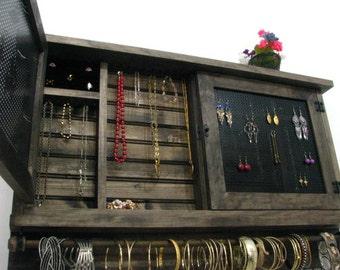 Jewelry cabinet earring holder