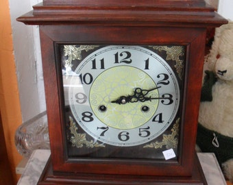 small table clock in wooden case 50 x 30 cm