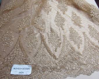 Magnificent French design bridal wedding embroider fabric mesh lace skin color. Sold by yard.