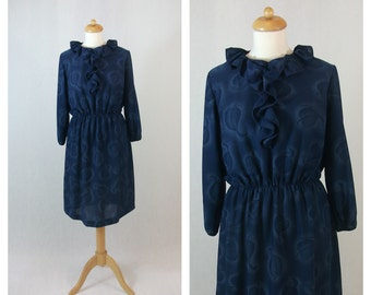 70s vintage dress. Blue with leaves print. Ruffle dress. Ruffle collar. Size M - L.