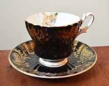 Queen Anne Black and Gold China teacup with saucer, Fine Bone China England. Hand Numbered 413