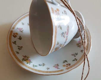 Lovely china tea cup bird feeder