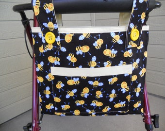 "Walker Bag. Walker tote. Bee themed walker tote bag. Yellow bees on black.  Yellow lining. Front pocket. Velcro closure. Size 15"" W x 12"" D."