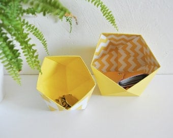 Origami boxes by two Scandinavian geometric motifs, chevrons yellow and white