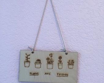 Unique plants are friends engraved wooden signs