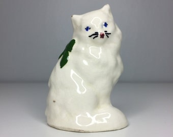 small vintage ceramic cat figurine with blue bow