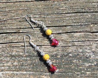 Red crystals and yellow bead earrings
