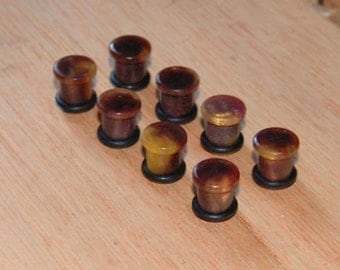 0g  plugs turned from cast resin
