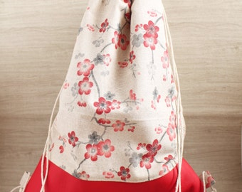Red flowers and leather bottom backpack bag