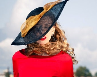 Barbara - large hat from sinamey black with a golden bow.