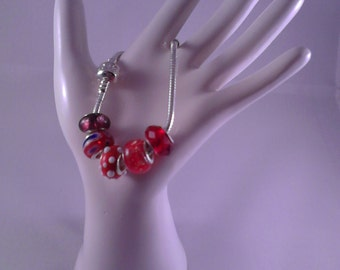 """Red glass and silver charms on 19"""" bracelet"""