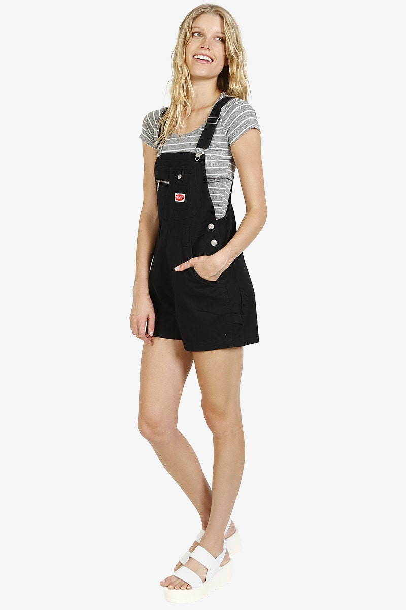 We can see it clear as day: you strutting your stuff in the Billabong Free to Roam Black Short Overalls! Lightweight woven rayon creates a classic overall silhouette, supported by crisscrossing straps that fasten with buttons (and two length options) at back.4/5(2).