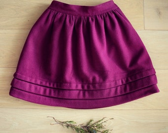 SALE 50% OFF!! Wool skirt in pomegranate with pleat detail.