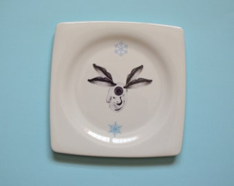 Illustrated porcelain plate