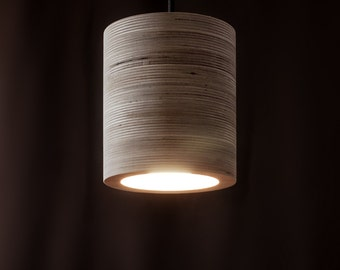 C-light. Cylindrical ceiling lamp made of plywood