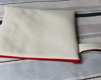 White and red faux leather pouch