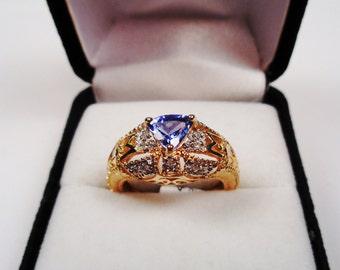 Tanzanite Trillion in 14kt.Gold Filigree Ring with Diamonds.