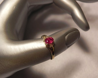 14k Gold Ring with Ruby and diamonds Size 7