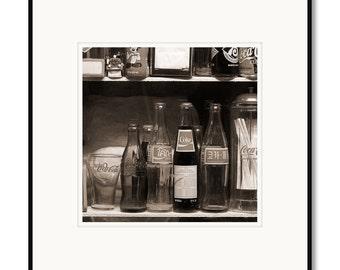 Black and white photography, sepia prints, Coca Cola bottles, vintage Coke, antique Coke bottles, still life photograph, framed matted print