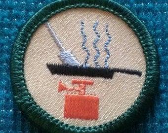 Outdoor cook retired Girl Scout Junior badge