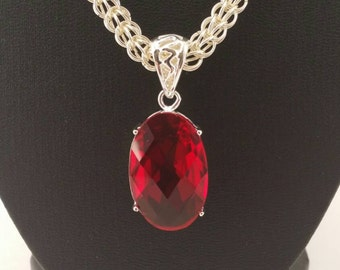 Ruby red pendant on a full persian weave silver plated chain maille necklace
