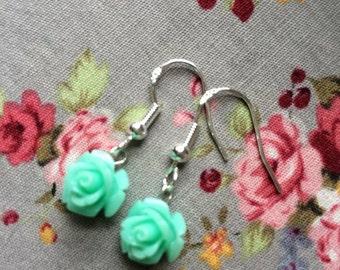 Sterling silver earrings with mint green flower