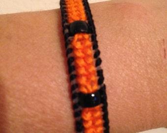 Friendship Bracelet in Plastic Canvas-Orange with Black Beads