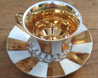 Vintage 1950s Stunning Delicate white and Gold Tea Cup & Saucer with floral detail and gilt inside, in Perfect Condition.