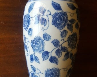 large heavy tall ewer urn shaped vintage white ceramic pottery vase with blue flora roses and a wide mouth