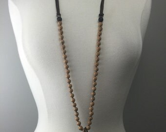 Hand knotted beaded necklace with leather adjustable ties and soldered horn